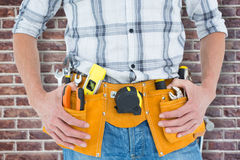 Composite image of cropped image of technician with tool belt around waist Stock Images