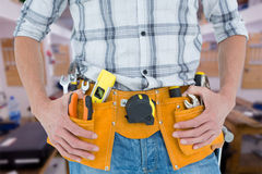 Composite image of cropped image of technician with tool belt around waist Royalty Free Stock Images