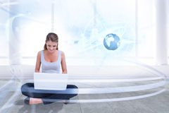 Composite image of cross legged woman using a laptop Stock Images