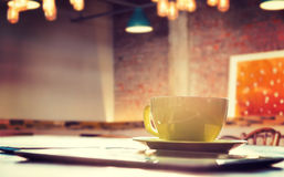 Composite image of cup of coffee and tablet pc Royalty Free Stock Photos