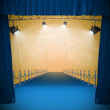 Composite image of curtains of blue color. 3d Curtains of blue color against image of spotlight Royalty Free Stock Photos