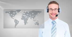 Composite image of customer service executive with world map interface. Against grey background Royalty Free Stock Photo