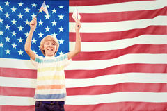 Composite image of cute boy with american flag Royalty Free Stock Photography