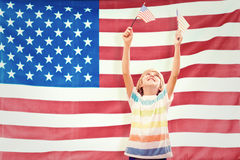 Composite image of cute boy with american flag Stock Image