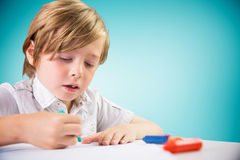 Composite image of cute boy colouring Stock Images