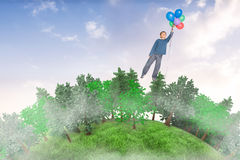 Composite image of cute boy holding balloons Royalty Free Stock Photography