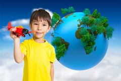 Composite image of cute boy playing with toy airplane Royalty Free Stock Photo