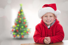 Composite image of cute boy in santa hat Stock Photos