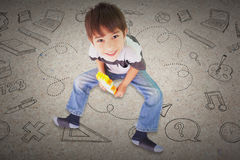 Composite image of cute boy sitting with building blocks Royalty Free Stock Photography