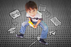 Composite image of cute boy sitting with building blocks Royalty Free Stock Images