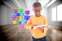 Composite image of cute boy using his tablet pc Royalty Free Stock Photo