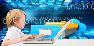 Composite image of cute boy using laptop. Cute boy using laptop against composite image of cloud computing drawer Royalty Free Stock Images