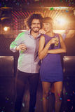 Composite image of cute couple dancing together on dance floor while having drink stock photos