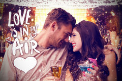 Composite image of cute couple drinking Royalty Free Stock Photo