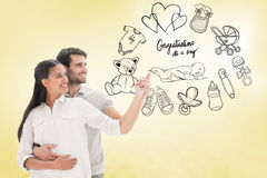 Composite image of cute couple embracing and pointing Royalty Free Stock Photo