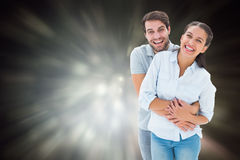 Composite image of cute couple hugging and smiling at camera Stock Photography