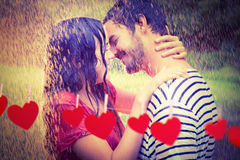 Composite image of cute couple hugging under the rain Royalty Free Stock Images