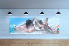 Composite image of cute couple kissing underwater in the swimming pool Stock Images