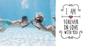 Composite image of cute couple kissing underwater in the swimming pool. Cute couple kissing underwater in the swimming pool against valentines message Royalty Free Stock Images