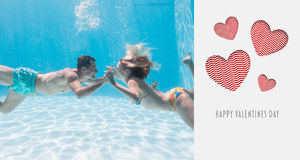Composite image of cute couple kissing underwater in the swimming pool. Cute couple kissing underwater in the swimming pool against cute valentines message Stock Photos