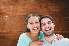 Composite image of cute couple smiling at camera Stock Images