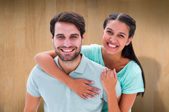 Composite image of cute couple smiling at camera Royalty Free Stock Photography