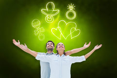 Composite image of cute couple standing with arms out Stock Images