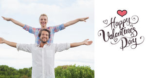 Composite image of cute couple standing outside with arms outstretched Stock Images
