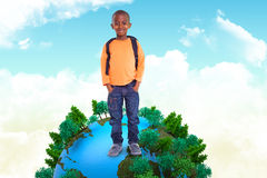 Composite image of cute elementary pupil smiling at camera Royalty Free Stock Image