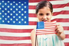 Composite image of cute girl with american flag Royalty Free Stock Image
