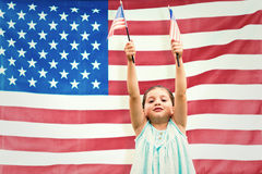 Composite image of cute girl with american flag Stock Image