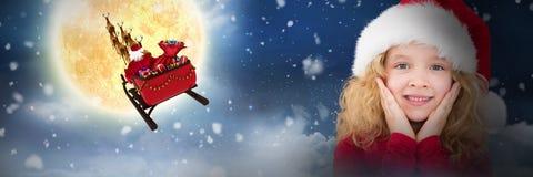 Composite image of cute girl in santa hat. Cute girl in santa hat against night sky stock image