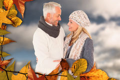 Composite image of cute happy couple romancing Royalty Free Stock Photo