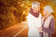 Composite image of cute happy couple romancing Stock Photo