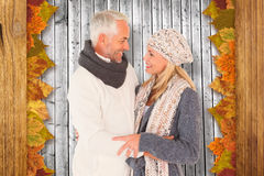Composite image of cute happy couple romancing Royalty Free Stock Image