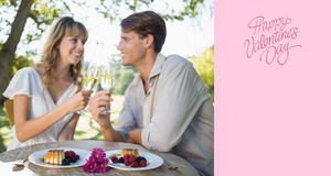 Composite image of cute happy couple sitting outside toasting with champagne with dessert Royalty Free Stock Photo
