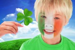 Composite image of cute irish boy Stock Photos
