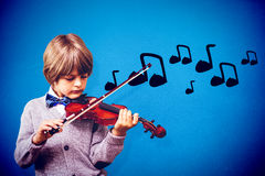 Composite image of cute little boy playing violin Royalty Free Stock Image