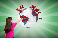Composite image of cute little girl pointing with finger Stock Photo