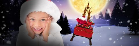 Composite image of cute little girl wearing santa hat. Cute little girl wearing santa hat against christmas house under full moon royalty free stock photos