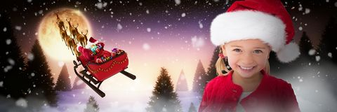 Composite image of cute little girl wearing santa hat. Cute little girl wearing santa hat against full moon over snowy landscape and house royalty free stock image