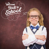 Composite image of cute pupil with arms crossed Royalty Free Stock Photos