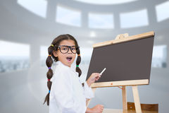 Composite image of cute pupil with chalkboard Royalty Free Stock Photos