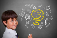 Composite image of cute pupil with chalkboard Royalty Free Stock Photo