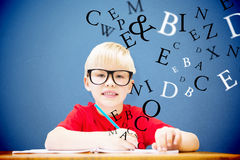 Composite image of cute pupil at desk Royalty Free Stock Photos