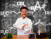 Composite image of cute pupil dressed up as scientist Stock Photos