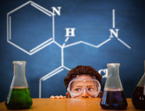 Composite image of cute pupil dressed up as scientist Stock Image