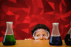 Composite image of cute pupil dressed up as scientist Stock Photo