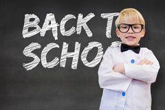 Composite image of cute pupil dressed up as teacher Royalty Free Stock Images