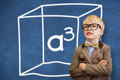 Composite image of cute pupil dressed up as teacher. Cute pupil dressed up as teacher  against blue chalkboard with a cubed Stock Images
